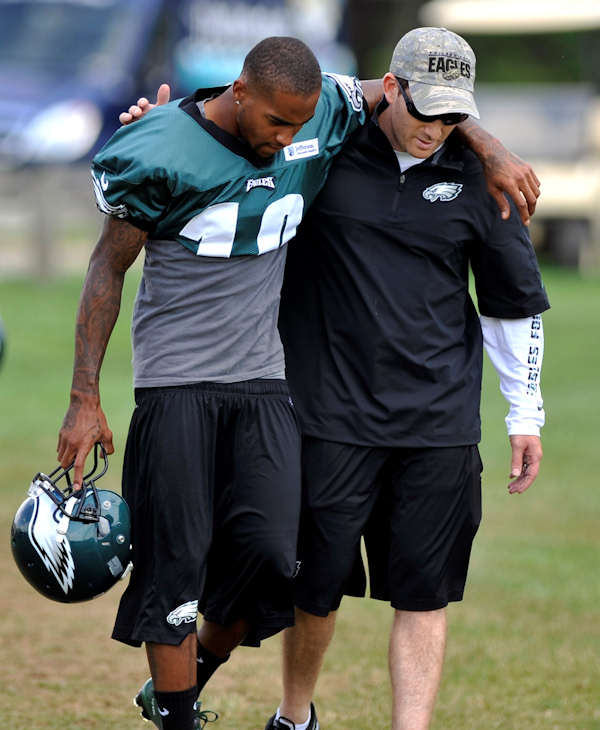 Philadelphia Eagles wide receiver DeSean Jackson, left, and general manager Howard Roseman walk to the field for NFL football practice, Sunday, Aug. 5, 2012, in Bethlehem, Pa. Garrett Reid, the oldest son of Eagles head coach Andy Reid, was found dead Sunday morning in his room at the club's training camp at Lehigh University. He was 29. (AP Photo/Chris Post)