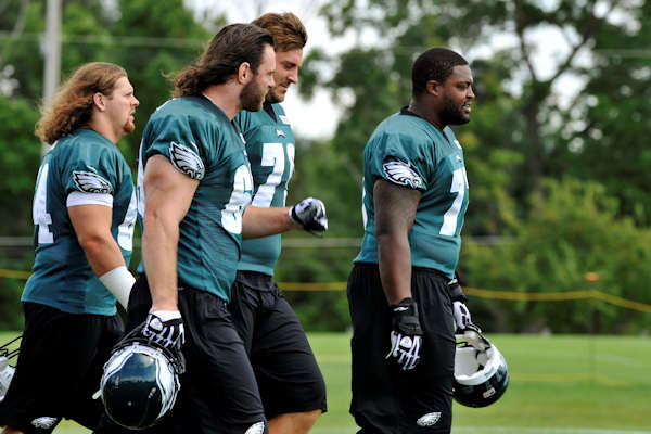 Philadelphia Eagles players take the field for NFL football practice, Sunday, Aug. 5, 2012, in Bethlehem, Pa. Garrett Reid, the oldest son of Eagles head coach Andy Reid, was found dead Sunday morning in his room at the club's training camp at Lehigh University. He was 29. (AP Photo/Chris Post)