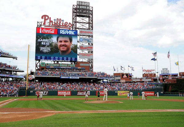A moment of silence is observed for Philadelphia Eagles head coach Andy Reid's son Garrett before the start of a baseball game between the Philadelphia Phillies and the Arizona Diamondbacks, Sunday, Aug. 5, 2012, in Philadelphia. Reid was found dead Sunday morning in his room at the club's training camp at Lehigh University. He was 29. (AP Photo/Michael Perez)