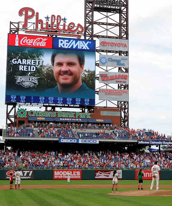 A moment of silence is observed for Philadelphia Eagles head coach Andy Reid's son Garrett before the start of a baseball game between the Philadelphia Phillies and the Arizona Diamondbacks, Sunday, Aug. 5, 2012, in Philadelphia. Garrett Reid was found dead Sunday morning in his room at the club's training camp at Lehigh University. He was 29. (AP Photo/Michael Perez)