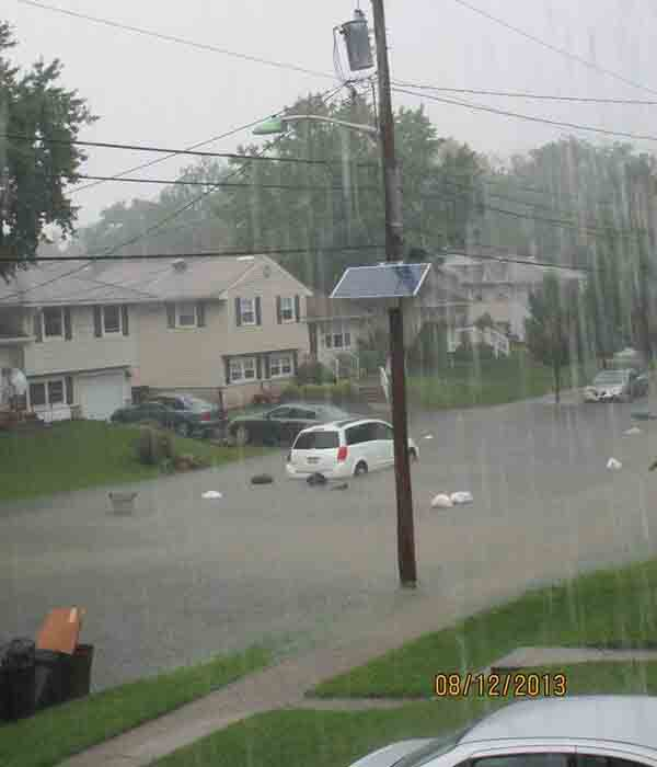 "6abc viewer Mary Smerdon Raws sent us this picture with the caption: ""SOAKED: Trash day in Blackwood, NJ, & the trash is floating in the street"""