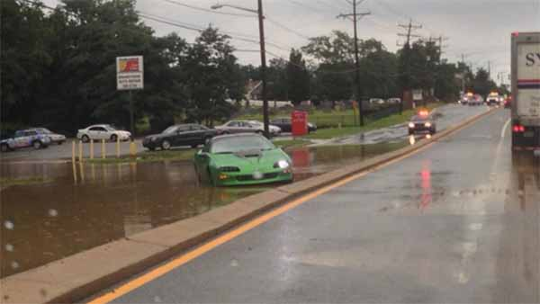 "Jennifer Price tweeted us with this pictrue, saying, "" Small green car stuck in high water closes Kirkwood highway west of Polly Drummond. @6abc"""