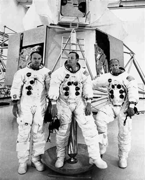 The Apollo 11 crew members stand before a lunar module mockup in a pose for photographs before they started training session for their July moon journey in Cape Kennedy, Florida, Thursday, June 19, 1969. From left: command pilot Michael Collins, commander Neil A. Armstrong and lunar module pilot Edwin E. Aldrin Jr. (AP Photo)