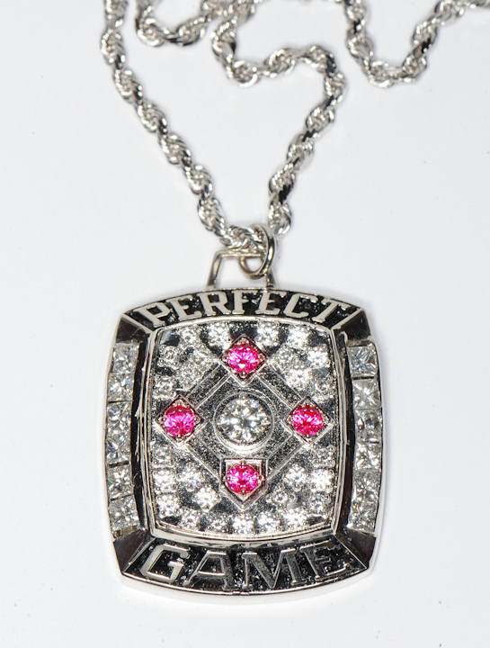 "<div class=""meta ""><span class=""caption-text "">The Perfect Game pendant celebrating Roy Halladay's perfect game against the Florida Marlins is shown. (The Phillies/Miles Kennedy)</span></div>"