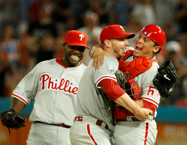 Philadelphia Phillies starting pitcher Roy Halladay, center, celebrates with Carlos Ruiz, right, and Ryan Howard after Halladay threw a perfect game during a baseball game against the Florida Marlins, Saturday, May 29, 2010 in Miami. The Phillies defeated the Marlins 1-0.  <span class=meta>(AP Photo&#47;Wilfredo Lee)</span>