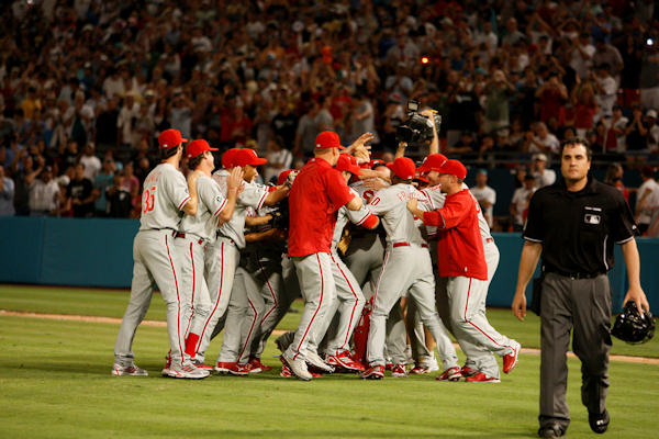 Philadelphia Phillies starting pitcher Roy Halladay is mobbed by teammates after he threw a perfect game during a baseball game against the Florida Marlins, Saturday, May 29, 2010 in Miami. The Phillies defeated the Marlins 1-0.  <span class=meta>(AP Photo&#47;Wilfredo Lee)</span>