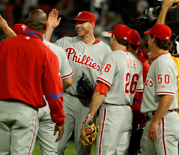 Philadelphia Phillies starting pitcher Roy Halladay is congratulated by teammates after he threw a perfect game during a baseball game against the Florida Marlins, Saturday, May 29, 2010 in Miami. The Phillies defeated the Marlins 1-0.  <span class=meta>(AP Photo&#47;Wilfredo Lee)</span>
