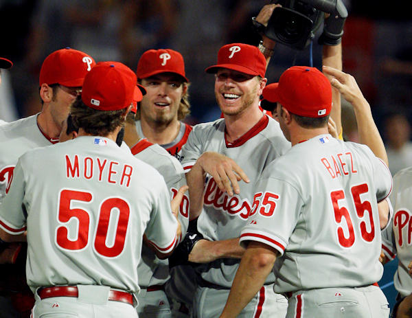 Philadelphia Phillies starting pitcher Roy Halladay, second from right, is mobbed by teammates after throwing a perfect baseball game against the Florida Marlins, Saturday, May 29, 2010, in Miami. The Phillies defeated the Marlins 1-0. <span class=meta>(AP Photo&#47;Wilfredo Lee)</span>