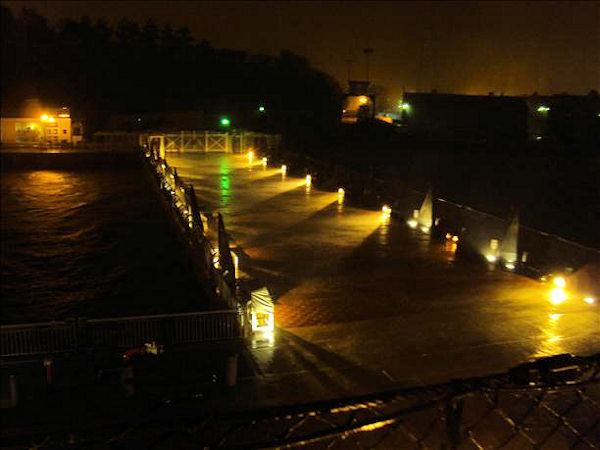 "<div class=""meta ""><span class=""caption-text "">Hurricane Irene blowing water from the Delaware River over the Pier of the Battleship New Jersey on Saturday night  Viewer photo of damage from Hurricane Irene submitted through sendit.6abc.com</span></div>"