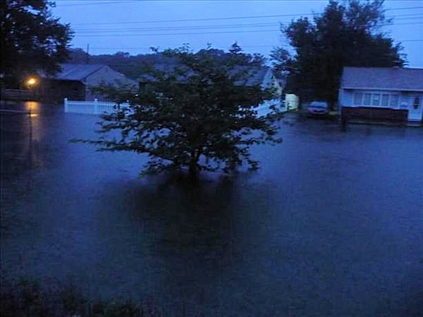 Flooding in Bristol Township, Pa.  The water is at least chest deep in the street. The water is up to the front doors of the houses.  Viewer photo of damage from Hurricane Irene submitted through sendit.6abc.com