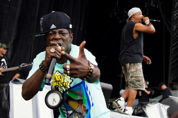 Flavor Flav, left, and Chuck D from the group Public Enemy perform on day one of the 2013 Budweiser Made in America Festival on Saturday, Aug. 31, 2013 in Philadelphia, PA. (Photo by Charles Sykes/Invision/AP)