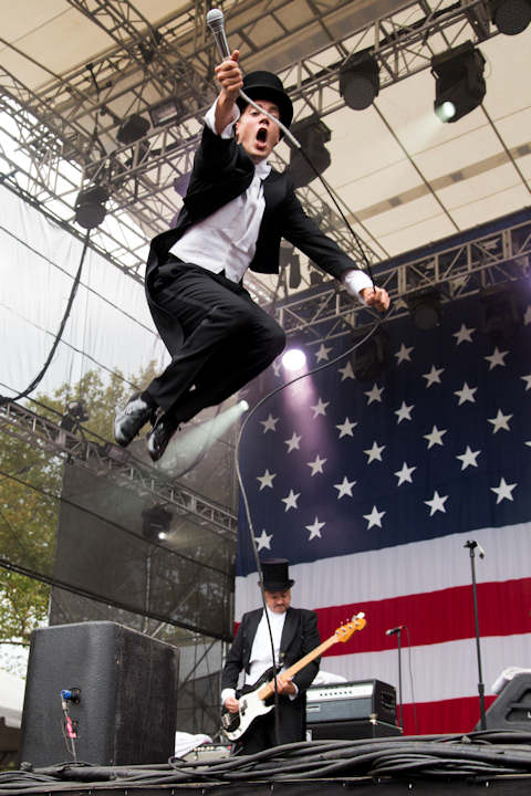 "Lead singer of The Hives Pelle Almqvist performs at the ""Made In America"" music festival on Sunday, Sept. 2, 2012, in Philadelphia, PA. (Photo by Charles Sykes/Invision/AP)"