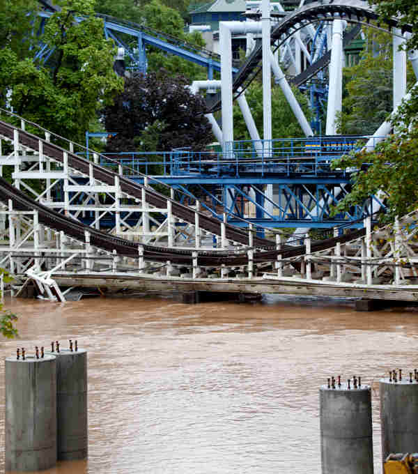 The floodwater of Spring Creek at Hershey Pa. are rising, coming dangerously close to the roller coasters in Hershey Park Thursday, Sept. 08, 2011. Up to 70,000 people from the area inundated by Hurricane Agnes nearly four decades ago were ordered to evacuate Thursday as widespread flooding brought on by the remnants of Tropical Storm Lee lashed on already waterlogged Pennsylvania and was blamed for four deaths.  <span class=meta>(AP Photo&#47;Daniel Shanken)</span>