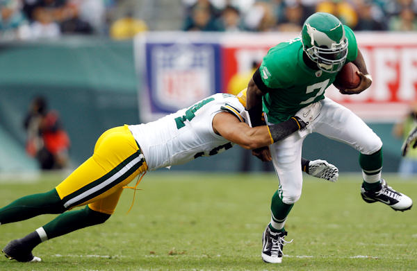 Philadelphia Eagles quarterback Michael Vick, right, is tackled by Green Bay Packers linebacker Brandon Chillar in the first half of an NFL football game, Sunday, Sept. 12, 2010, in Philadelphia. <span class=meta>(AP Photo&#47;Mel Evans)</span>