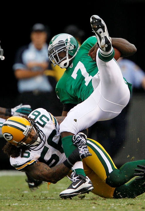 Philadelphia Eagles quarterback Michael Vick &#40;7&#41; is tackled by Green Bay Packers linebacker Nick Barnett &#40;56&#41; in the first half of an NFL football game, Sunday, Sept. 12, 2010, in Philadelphia.  <span class=meta>(AP Photo&#47;Matt Slocum)</span>