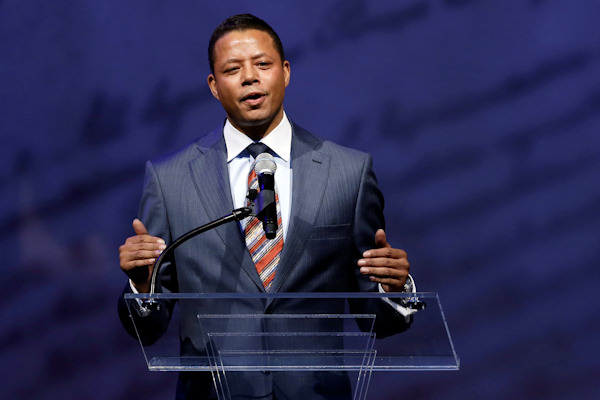 Actor Terrence Howard speaks before retired boxing champion Muhammad Ali receives the Liberty Medal during a ceremony at the National Constitution Center, Thursday, Sept. 13, 2012, in Philadelphia. The honor is given annually to an individual who displays courage and conviction while striving to secure liberty for people worldwide. (AP Photo/Matt Rourke)