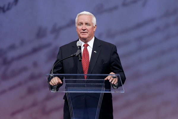 Pennsylvania Gov. Tom Corbett speaks before retired boxing champion Muhammad Ali received the Liberty Medal for his humanitarian work, during a ceremony at the National Constitution Center, Thursday, Sept. 13, 2012, in Philadelphia. (AP Photo/Matt Rourke)