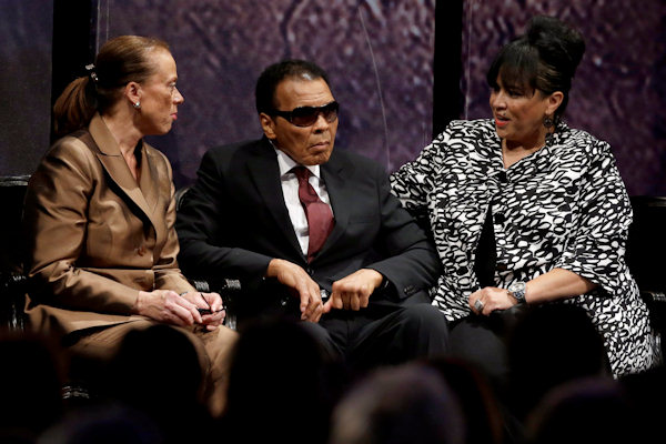 Retired boxing champion Muhammad Ali listens to speakers alongside his wife Lonnie Ali, left, and his sister-in-law Marilyn Williams, right, before receiving the Liberty Medal during a ceremony at the National Constitution Center, Thursday, Sept. 13, 2012, in Philadelphia. The honor is given annually to an individual who displays courage and conviction while striving to secure liberty for people worldwide. (AP Photo/Matt Rourke)
