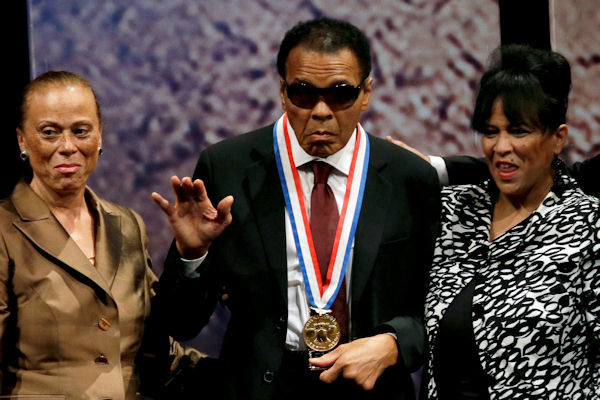 "<div class=""meta ""><span class=""caption-text "">Retired boxing champion Muhammad Ali, center, waves alongside his wife Lonnie Ali, left, and his sister-in-law Marilyn Williams, right, after receiving the Liberty Medal during a ceremony at the National Constitution Center, Thursday, Sept. 13, 2012, in Philadelphia. The honor is given annually to an individual who displays courage and conviction while striving to secure liberty for people worldwide. (AP Photo/Matt Slocum)  </span></div>"
