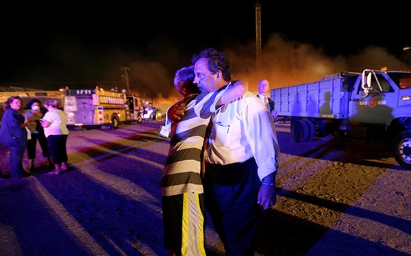 "<div class=""meta ""><span class=""caption-text "">New Jersey Gov. Chris Christie, right, is hugged by Michael Cisneros, 14, during a visit to the area hit by a massive fire on the Seaside Park boardwalk, Thursday, Sept. 12, 2013, in Seaside Park, N.J. The fire apparently started in an ice cream shop and spread several blocks down the boardwalk to neighboring Seaside Heights.  (AP Photo/Julio Cortez)</span></div>"