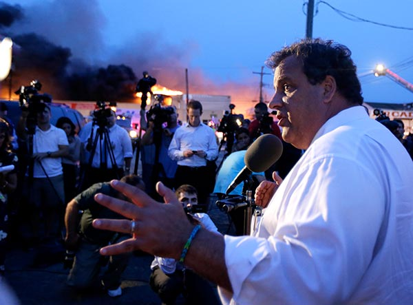 "<div class=""meta ""><span class=""caption-text "">New Jersey Gov. Chris Christie addresses the media near the area hit by a massive fire on Thursday, Sept. 12, 2013, in Seaside Park, N.J. The fire began in a frozen custard stand on the Seaside Park section of the boardwalk and quickly spread north into neighboring Seaside Heights.    (AP Photo/Julio Cortez)</span></div>"
