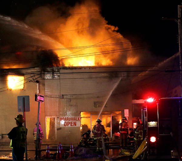 Firefighters battle a blaze in a building on the Seaside Park boardwalk on Thursday, Sept. 12, 2013, in Seaside Park, N.J. The fire began in a frozen custard stand on the Seaside Park section of the boardwalk and quickly spread north into neighboring Seaside Heights.  <span class=meta>(AP Photo&#47;Julio Cortez)</span>