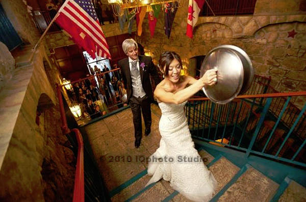 Nydia and Dennis banged pots and pans with the chef at The Culinary Institute of America at Greystone to signal their guests should head into the wine barrel room for dinner <span class=meta>(IQphoto studio)</span>