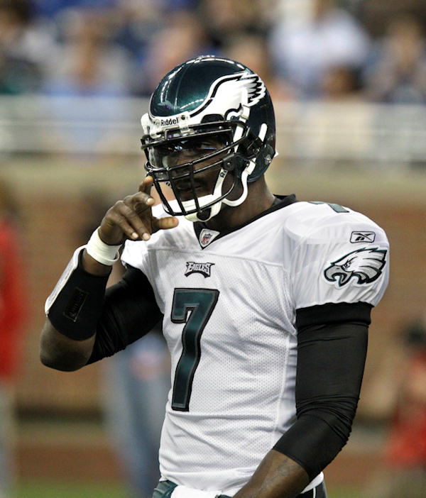 Philadelphia Eagles quarterback Michael Vick &#40;7&#41; adjusts his helmet before the first quarter of an NFL football game against the Detroit Lions at Ford Field in Detroit, Sunday, Sept. 19, 2010. <span class=meta>(AP Photo&#47;Carlos Osorio)</span>