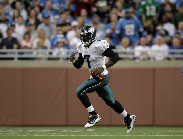 "<div class=""meta image-caption""><div class=""origin-logo origin-image ""><span></span></div><span class=""caption-text"">Philadelphia Eagles quarterback Michael Vick runs against the Detroit Lions during the first half of an NFL football game in Detroit, Sunday, Sept. 19, 2010.  (AP Photo/Paul Sancya)</span></div>"