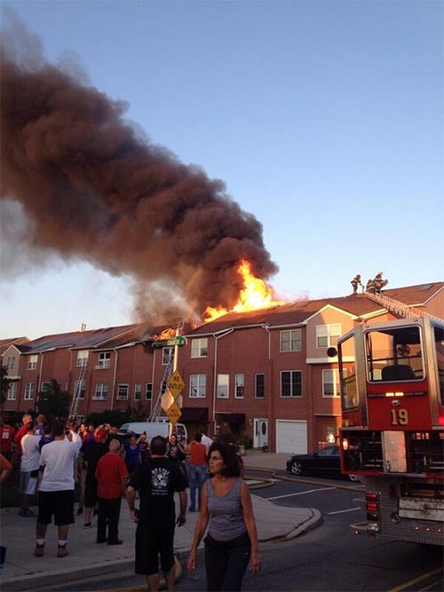 "<div class=""meta ""><span class=""caption-text "">@_JacquelynPasq_ tweeted us this photo of the fire that tore through multiple homes on the 3200 block of Chaucer Street in South Philadelphia.</span></div>"