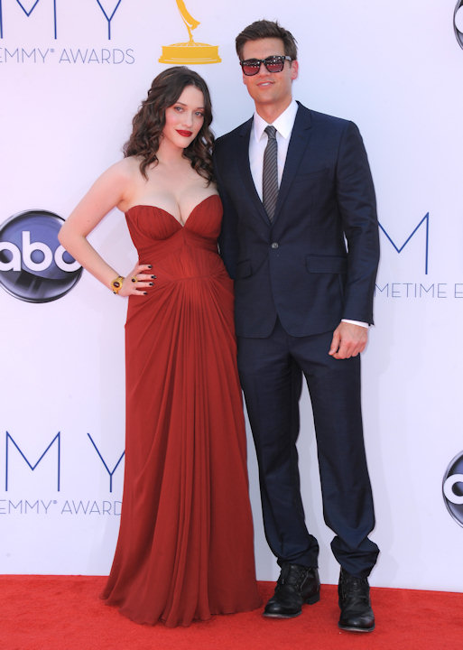 Actors Kat Dennings, left and Nick Zano arrive at the 64th Primetime Emmy Awards at the Nokia Theatre on Sunday, Sept. 23, 2012, in Los Angeles. (Photo by Jordan Strauss/Invision/AP)