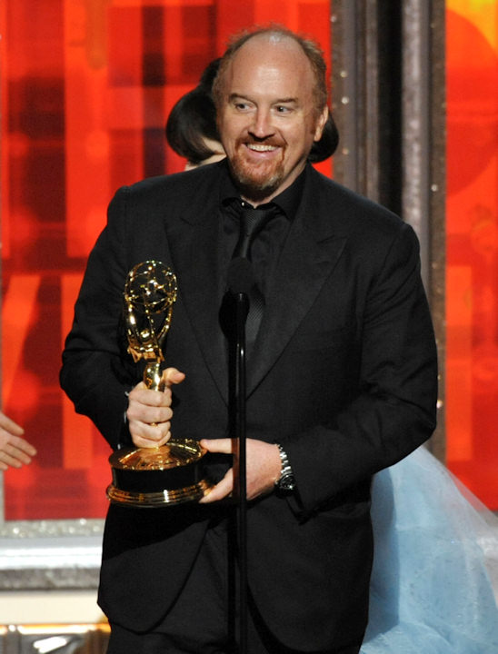 "<div class=""meta image-caption""><div class=""origin-logo origin-image ""><span></span></div><span class=""caption-text"">Louis C.K. accepts the award for outstanding writing in a comedy series to for ""Louie"" at the 64th Primetime Emmy Awards at the Nokia Theatre on Sunday, Sept. 23, 2012, in Los Angeles. (Photo by John Shearer/Invision/AP) </span></div>"