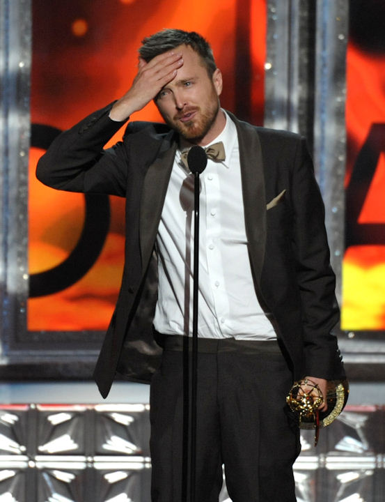 "Aaron Paul accepts the award for outstanding supporting actor in a drama series for ""Breaking Bad"" at the 64th Primetime Emmy Awards at the Nokia Theatre on Sunday, Sept. 23, 2012, in Los Angeles. (Photo by John Shearer/Invision/AP)"