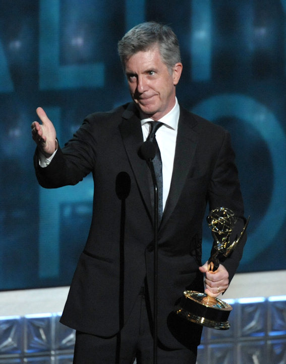 "Tom Bergeron accepts the award for Outstanding Host For A Reality Or Reality-competition Program for ""Dancing With The Stars"" at the 64th Primetime Emmy Awards at the Nokia Theatre on Sunday, Sept. 23, 2012, in Los Angeles. (Photo by John Shearer/Invision/AP)"