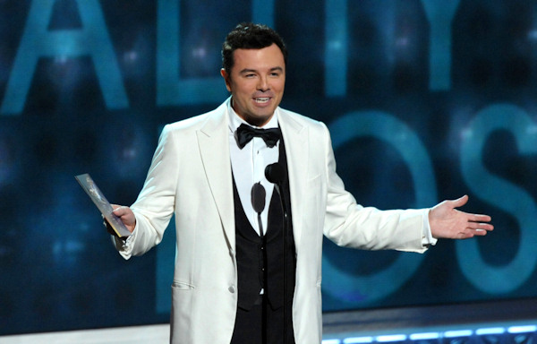 Seth MacFarlane presents an award onstage at the 64th Primetime Emmy Awards at the Nokia Theatre on Sunday, Sept. 23, 2012, in Los Angeles. (Photo by John Shearer/Invision/AP)