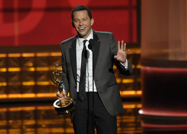 "Jon Cryer accepts the award for outstanding lead actor in a comedy series for ""Two And A Half Men"" at the 64th Primetime Emmy Awards at the Nokia Theatre on Sunday, Sept. 23, 2012, in Los Angeles. (Photo by John Shearer/Invision/AP)"
