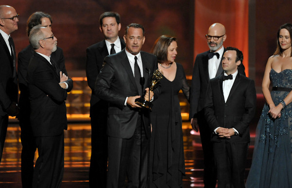 "Tom Hanks, center, and the cast and crew of ""Game Change"" accept the award for outstanding miniseries or movie for at the 64th Primetime Emmy Awards at the Nokia Theatre on Sunday, Sept. 23, 2012, in Los Angeles. (Photo by John Shearer/Invision/AP)"