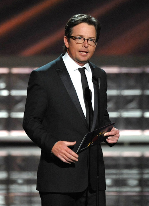 Michael J. Fox presents an award onstage at the 64th Primetime Emmy Awards at the Nokia Theatre on Sunday, Sept. 23, 2012, in Los Angeles. (Photo by John Shearer/Invision/AP)