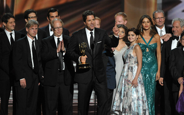 "<div class=""meta image-caption""><div class=""origin-logo origin-image ""><span></span></div><span class=""caption-text"">Steven Levitan, center, and the cast and crew of ""Modern Family"" accept the outstanding comedy series award at the 64th Primetime Emmy Awards at the Nokia Theatre on Sunday, Sept. 23, 2012, in Los Angeles. (Photo by John Shearer/Invision/AP)  </span></div>"