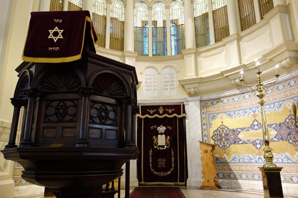 "<div class=""meta image-caption""><div class=""origin-logo origin-image ""><span></span></div><span class=""caption-text"">""Cape Town's 1st orthodox synagogue has 27 Torah's. 27!"" - @Jim_Gardner on Twitter (Jim Gardner/ @Jim_Gardner)</span></div>"
