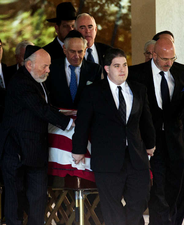 The flag-draped coffin of former U.S. Sen. Arlen Specter is taken from Har Zion Temple after his funeral, Tuesday, Oct. 16, 2012, in Penn Valley, Pa. Family members say Specter died Sunday of complications from non-Hodgkin's lymphoma. He was 82. (AP Photo/Matt Rourke)