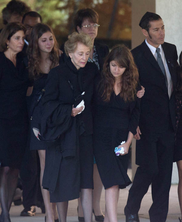 Joan Specter, third from left, and others leaves Har Zion Temple after her husband, former U.S. Sen. Arlen Specter's funeral, Tuesday, Oct. 16, 2012, in Penn Valley, Pa. Family members say Specter died Sunday of complications from non-Hodgkin's lymphoma. He was 82. (AP Photo/Matt Rourke)