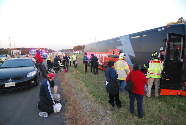 "<div class=""meta ""><span class=""caption-text "">Crews respond to the scene after a BoltBus collided with another vehicle on I-95 in Newark, Delaware on October 24, 2012.</span></div>"