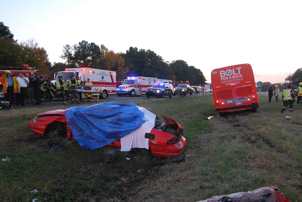 Crews respond to the scene after a BoltBus collided with another vehicle on I-95 in Newark, Delaware on October 24, 2012.