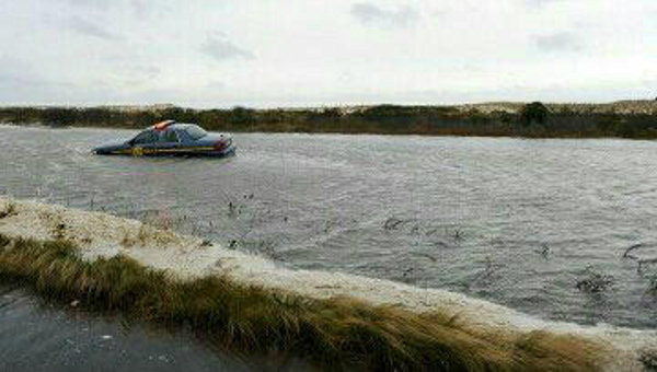 "Twitter user @Shawn_in_DE sent us this image with the caption: ""@6abc Dunes broke thru at Dewey Beach, DE. This is DE route 1 as of yesterday before #Sandy really got cranked up."""