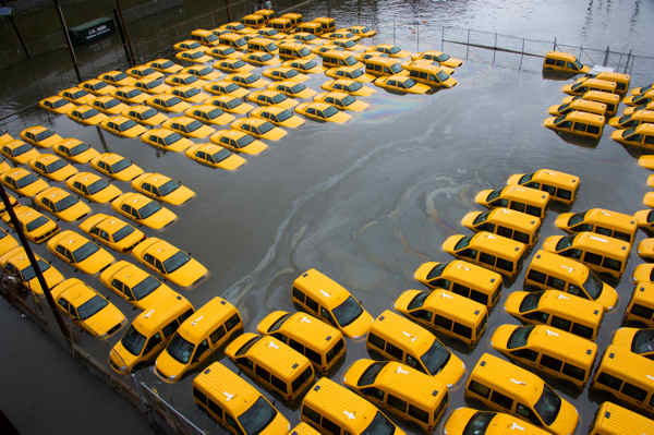 "<div class=""meta ""><span class=""caption-text "">A parking lot full of yellow cabs is flooded as a result of Hurricane Sandy on Tuesday, Oct. 30, 2012 in Hoboken, NJ.  (AP Photo/Charles Sykes)</span></div>"