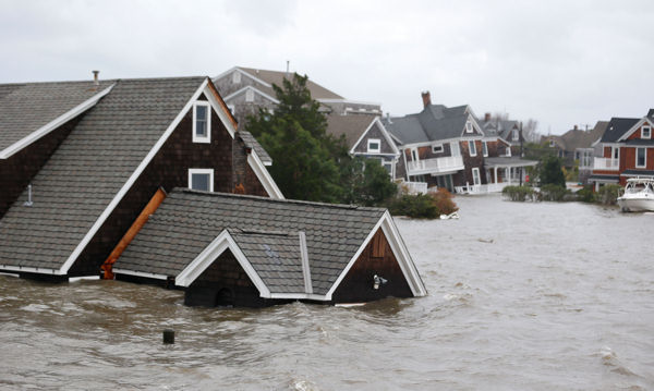 "<div class=""meta ""><span class=""caption-text "">Floodwaters surround homes near the Mantoloking Bridge the morning after hybrid storm Sandy rolled through, Tuesday, Oct. 30, 2012, in Mantoloking, N.J. Sandy, which was downgraded from a Hurricane just before making landfall in New Jersey, left millions without power.  (AP Photo/Julio Cortez)</span></div>"