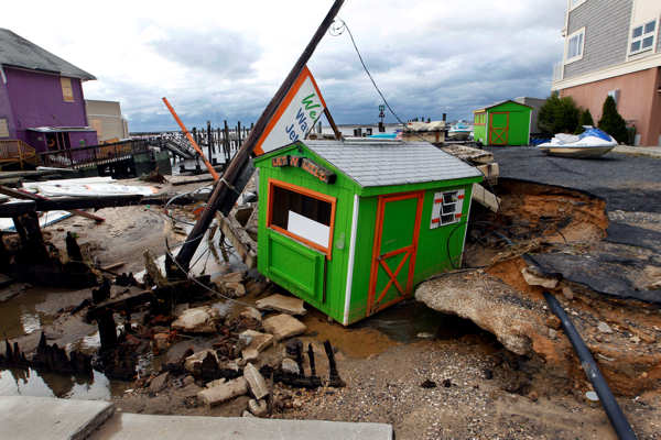 A small shop that rents personal water craft rests in a huge sinkhole on the bayside in Ocean City, N.J. Tuesday, Oct. 30, 2012 after a storm surge from superstorm Sandy Monday night.  <span class=meta>(AP Photo&#47;Mel Evans)</span>