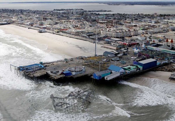 This aerial photo shows the damage to an amusement park left in the wake of superstorm Sandy on Wednesday, Oct. 31, 2012, in Seaside Heights, N.J. New Jersey got the brunt of Sandy, which made landfall in the state and killed six people. More than 2 million customers were without power as of Wednesday afternoon, down from a peak of 2.7 million.  <span class=meta>(AP Photo&#47;Mike Groll)</span>