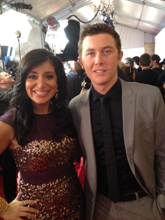 Alicia Vitarelli with Scotty McCreery on the red carpet of the Country Music Awards in Nashville on November 1, 2012.